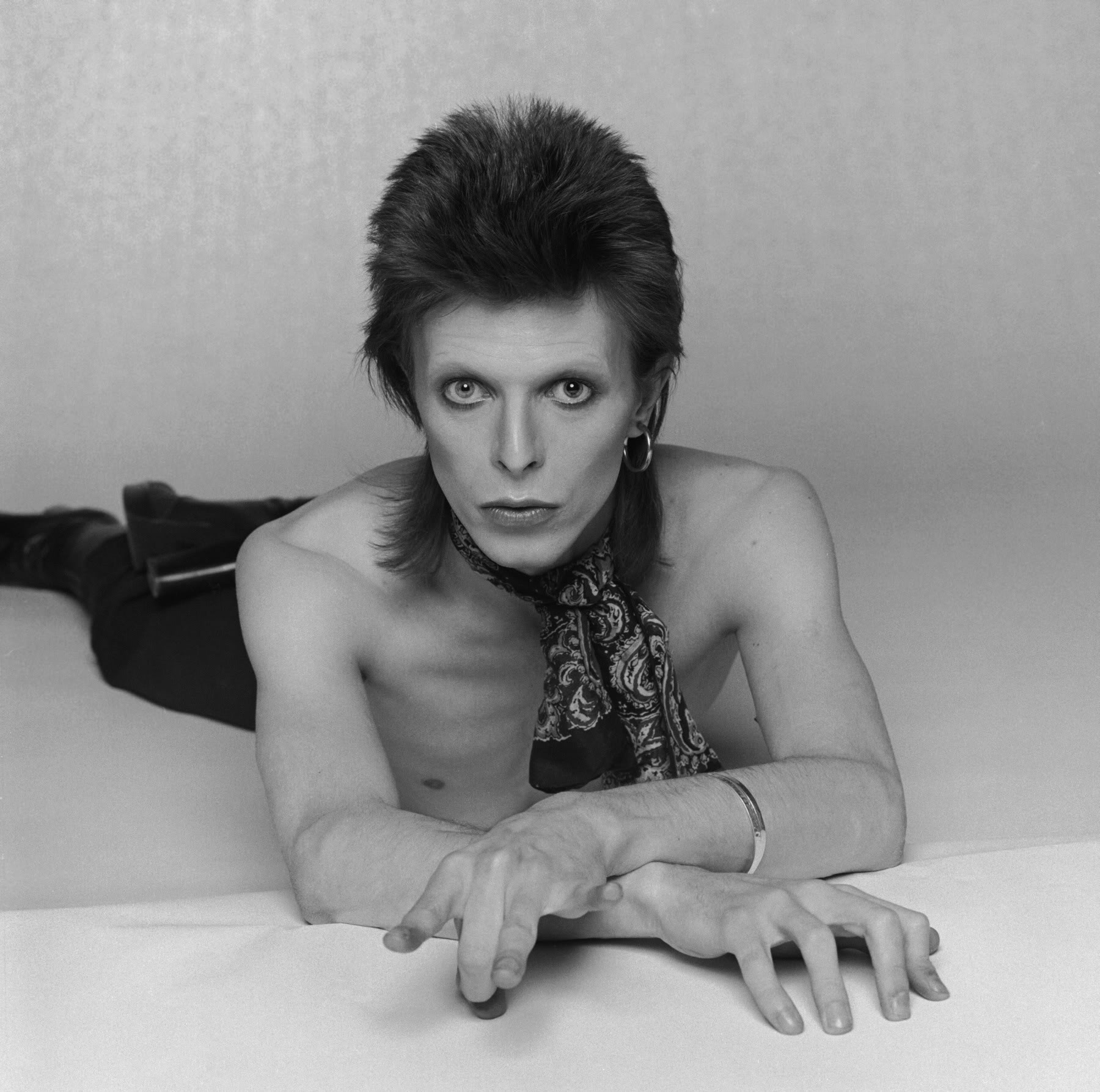 Bowie posing for the cover painting of 'Diamond Dogs'  (1974).