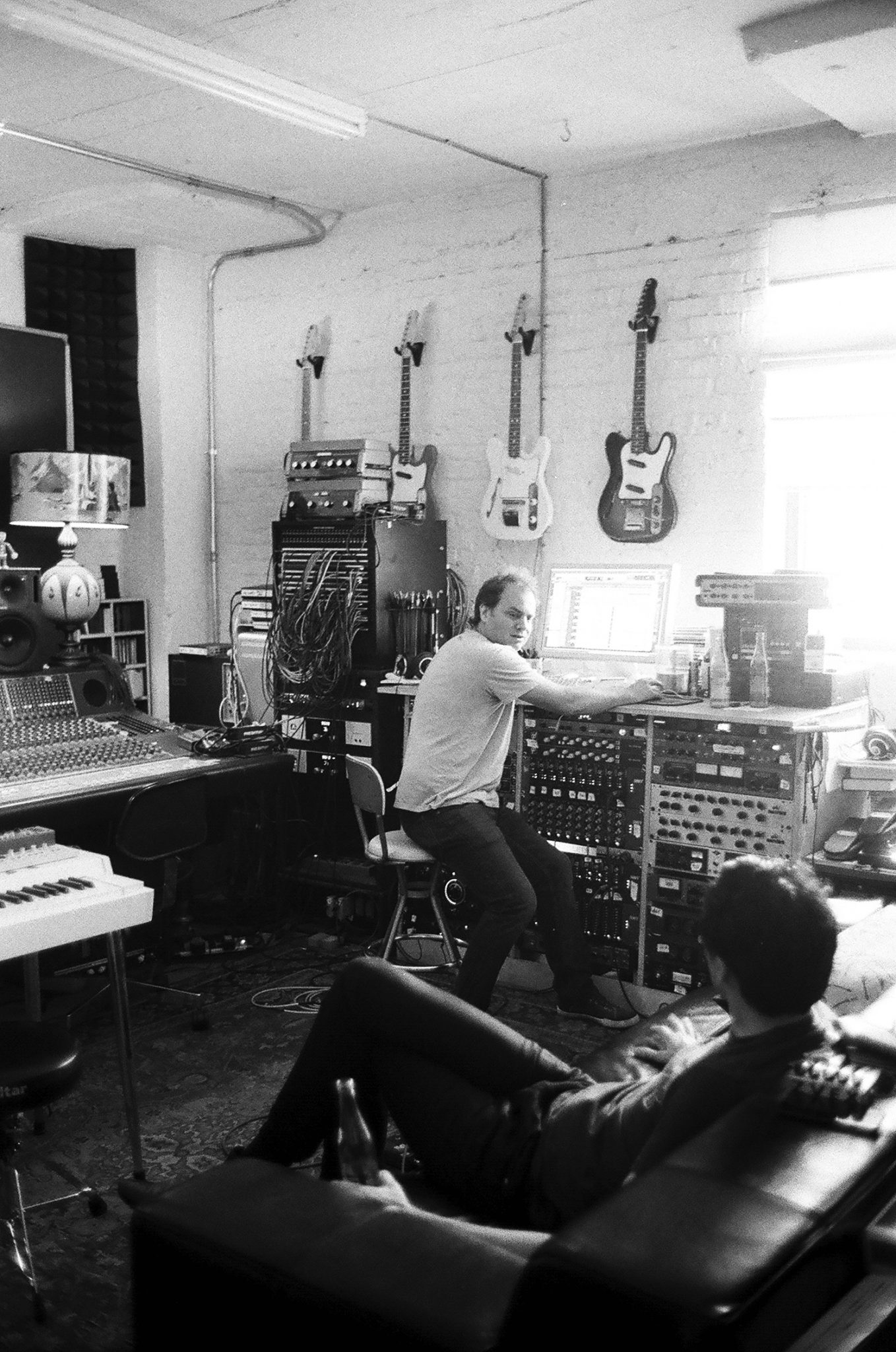 Engineer Tom Schick in a position you won't often catch him in at The Loft — sitting down at his Pro Tools workstation.