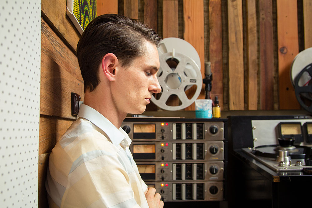 Alex Bennett mans the Ampex AG440B four-track machine and intently listens to takes in between.