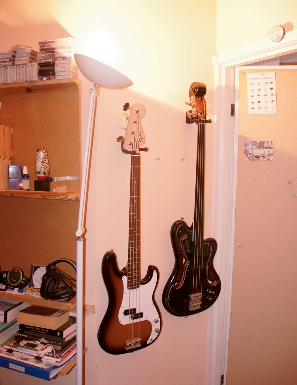 Eno's Bass guitars include a Squire and a fretless Ampeg.