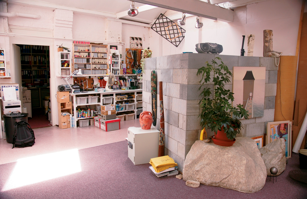 The organised creative chaos of Brian Eno's London-based workspace. Presumably the boulder is for getting that perfect 'big rock' sound. Note the digeridoo in the centre of the picture.