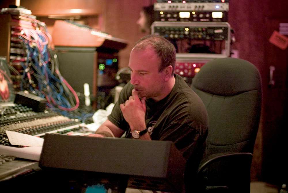 Joe at the Helm of the Vintage Neve console. Almost all of Lullabies to Paralyze was recorded through Sound City's Neve 8028 desk.