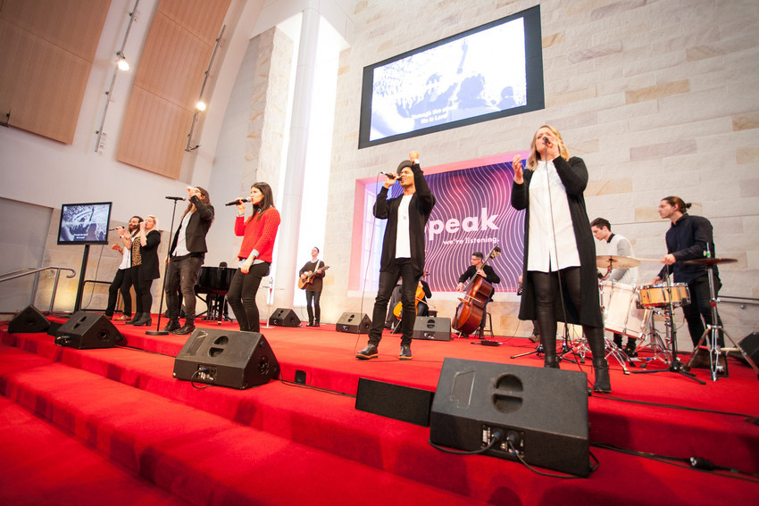Hillsong Church band on stage using Shure wireless microphone