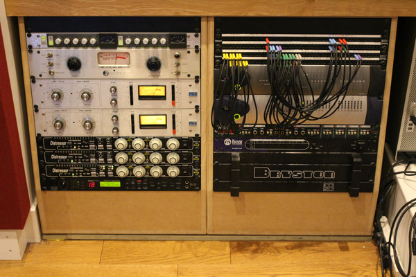 """OUTBOARD — When the console didn't work out, aside from monitoring systems, patch bays and cabling, the band had to buy a whole collection of preamps and outboard. Fawcus: """"It was predominantly API mic pres and EQs. We had 10 modern 512 preamps, one of those API 3124+ quad pre boxes and I got a couple of old '80s API 312 mic pres that Brent Averill racked up. We had a couple of Brent Averill's 1073s too and got a great deal on a Focusrite ISA115HD. We also had four vintage 550A EQs and a couple of the reissues."""" For compression, the band added a couple of ELI Distressors to the one they already owned, a couple of Urei 1176s, a Summit TLA-100A, Smart Research C2, and a couple of dbx 160XTs."""