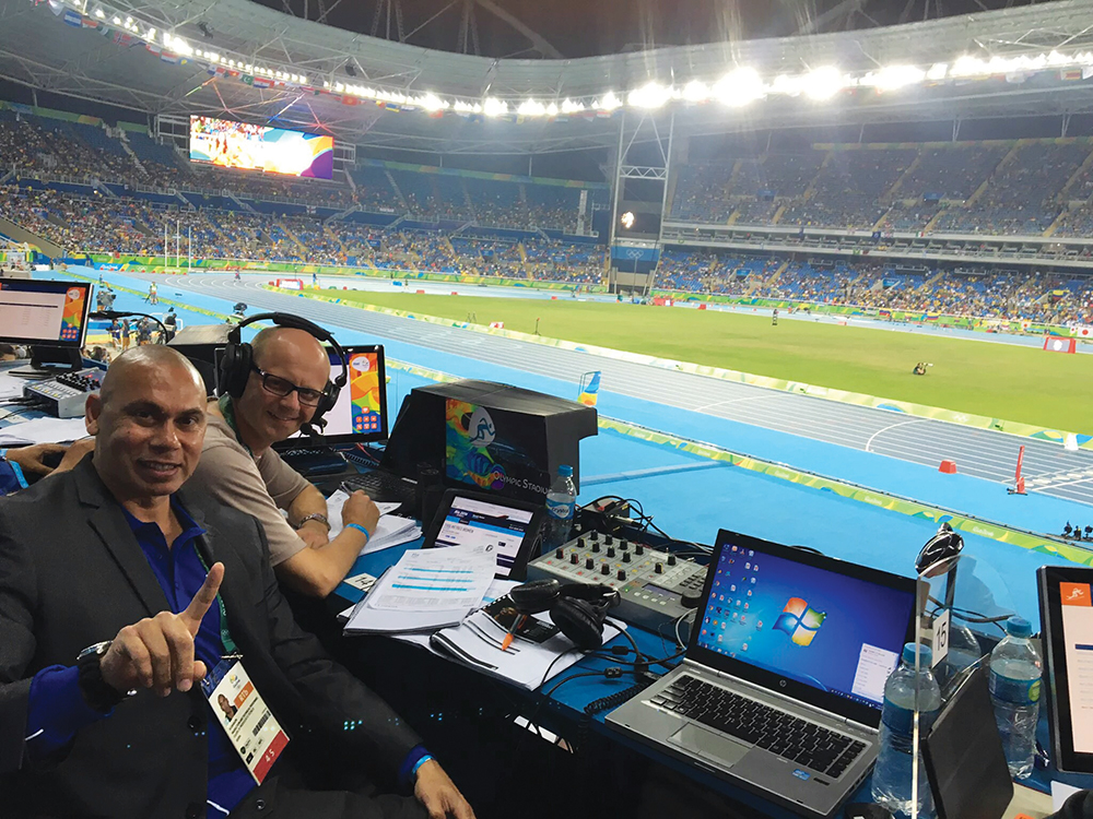 The games kick off. Quentin and former sub-10 second Olympic sprinter, Patrick Johnson, call the action from the stadium.
