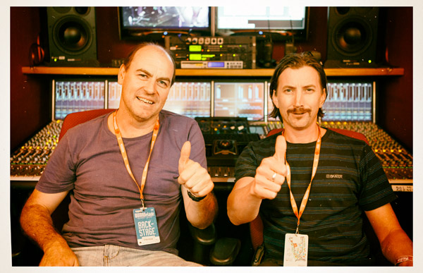 """Back in the OB Truck with Steve Fieldhouse (left) and Tom Henry (right) and the signals are coming through nice and clear. According to Tom, when he first started recording the festival in the late '90s, the ABC used several 70kg drums of copper-based Burndy multicores. At the time, the OB truck housed an old analogue MCI console and a 2-inch Otari analogue multi-track recorder. Steve: """"A few years ago we couldn't get the OB Truck here so we put together a portable recording system. It comprised five synced Sound Devices 788T field recorders strapped to a makeshift trolley, giving us a portable 40-channel recorder that worked surprisingly well… Sound Devices said it was the first time they'd heard of that many 788T units being synced for a recording."""""""