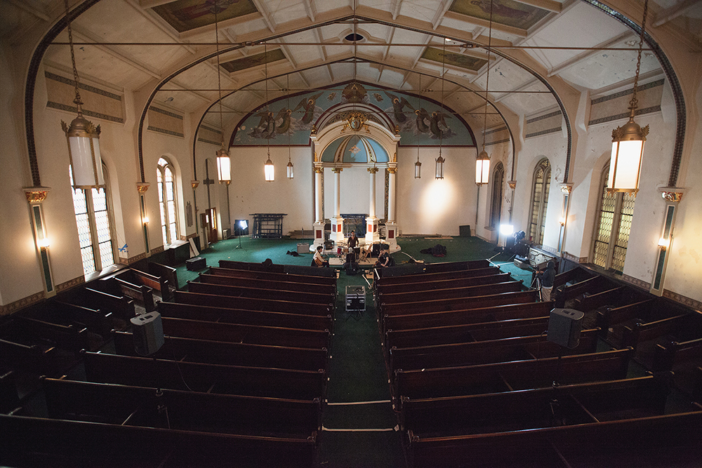 Nicholas Prout setup a PA inside the Hirsch Center. He used it to project vocals, miked with a Beyerdynamic M160, out into the church to enhance the natural reverb.