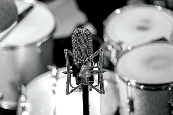 In the '50s, the idea was to position the single overhead mic so it captured the whole kit.