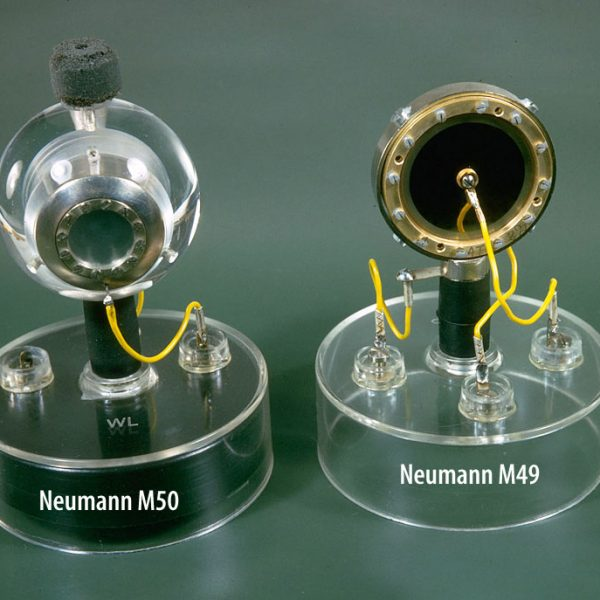 Neumann's M50 sphere-mounted edge-terminated single diaphragm (left), and K49 dual-diaphragm centre-terminated capsule from the M49 (same as K47 capsule but with a different name).